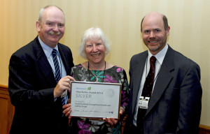John Cairns (left) Chairman, Safety Groups UK, presents Alan Butler Silver Award to SCOHSG representatives Valerie Kennedy and James Woolgrove.